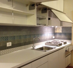 <span>Cucine su Misura in Legno</span><i>→</i>
